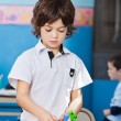 Boy Playing With Colorful Blocks In Classroom — Stock Photo #33077311