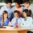Stock Photo: Teacher And Students Discussing Over Mobilephone In Classroom