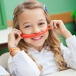 Girl Holding Mustache Made Of Clay In Preschool — Stock Photo #33077647