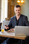 Business man With Mobilephone And Laptop In Restaurant — Stock Photo
