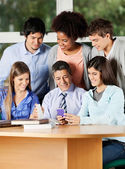 Teacher And Students Discussing Over Mobilephone In Classroom — Stock Photo