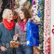 Mother And Daughter Shopping In Christmas Store — Stock Photo #33097769