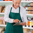 Stock Photo: Male Owner Using Tablet In Supermarket