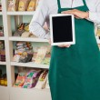 Stock Photo: Owner Showing Digital Tablet In Store