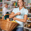 Stock Photo: Happy WomHolding Shopping Basket