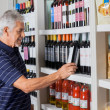 Senior Man Choosing Wine At Supermarket — Stock Photo