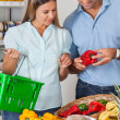 Couple Buying Vegetables In Grocery Store — Stock Photo