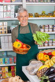 Senior Salesman Selling Vegetables In Supermarket — Stock Photo
