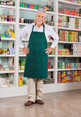 Senior Male Owner Standing In Supermarket — Stock Photo