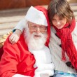 Boy And Santa Claus Using Smartphone — Stock Photo