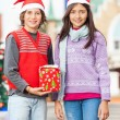 Smiling Friends With Christmas Gift — Stock Photo