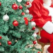 Decorated Christmas Tree With Santa Claus Sitting In Background — Stock Photo
