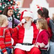 Children Playing With Santa Claus's Hat — Stockfoto
