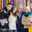Family Standing Against Tinsels At Christmas Store — Stock Photo