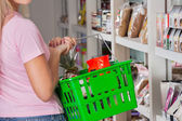 Midsection Of Woman Carrying Shopping Basket — Stock Photo