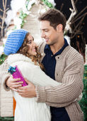 Romantic Couple Embracing At Christmas Store — Stock Photo