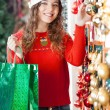 Woman With Shopping Bag Buying Christmas Ornaments — Stock Photo