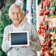 Happy Man Holding Digital Tablet In Christmas Store — Stock Photo #33110709