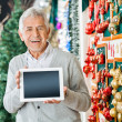 Happy Man Holding Digital Tablet In Christmas Store — Stock Photo