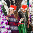 Stock Photo: Couple Shopping For Christmas Decorations