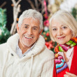 Happy Couple At Christmas Store — Stock Photo