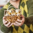 Man Holding Bauble Basket In Store — Stock Photo