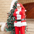 Santa Claus Standing Arms Crossed Outside House — Stock Photo