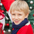 Cute Boy Receiving Gift From Santa Claus — Stock Photo #33122051