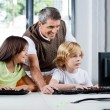 Happy Teacher Assisting Schoolchildren In Using Desktop Pc — Stock Photo