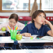 Stockfoto: Young Boy Looking Up In Classroom