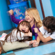 Playful Children Lying On Floor — Stock Photo #33164653
