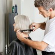 Hairdresser Examining Hair Length Of Client — Stock Photo