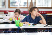 Young Boy Looking Up In Classroom — Stock Photo
