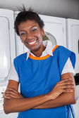 Female Helper Standing With Arms Crossed In Laundry — Stock Photo