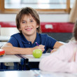 Portrait Of Happy Schoolboy Drawing At Classroom — Stock Photo