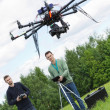 Stock Photo: Engineers Flying UAV Drone in Park