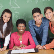 Teacher With High School Students At Desk — Foto Stock