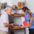 Father And Daughter Buying Muffins — Stock Photo