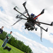 Stock Photo: Technicians Operating UAV Helicopter in Park