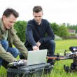 Technicians Using Laptop By UAV Drone — Stock Photo