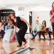 Friends Bowling in Club — ストック写真
