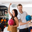 ������, ������: Excited Man And Woman Holding Bowling Balls