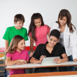 Teenage Friends Using Digital Tablet At Desk — Stock Photo