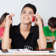 Teenage Male Student Using Phone In Classroom — Stock Photo #33208637