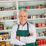 Senior Male Owner Smiling At Supermarket — Stock Photo