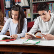 Stock Photo: Schoolchildren Reading Books In Library