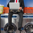 Businessman Using Laptop While Sitting On Washing Machine — Stock Photo