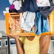 Woman Carrying Basket Of Dirty Clothes In Front Of Her Face — Stock Photo