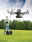 Man Flying UAV Helicopter in Park — Stock Photo