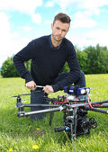 Technician Fixing Propeller Of UAV Octocopter — Stock Photo